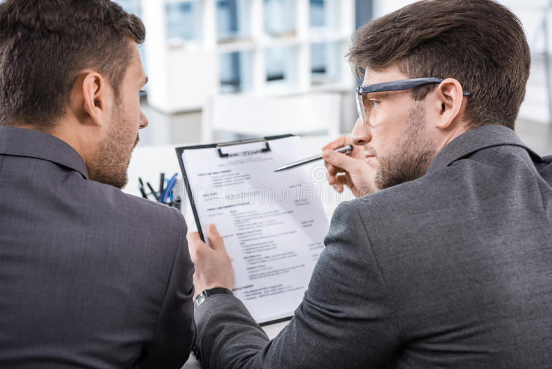 Successful businessmen discussing job interview contender royalty free stock image