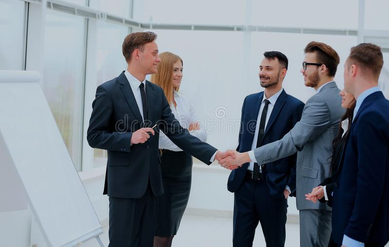 Successful businessmen handshaking after presentation. stock image