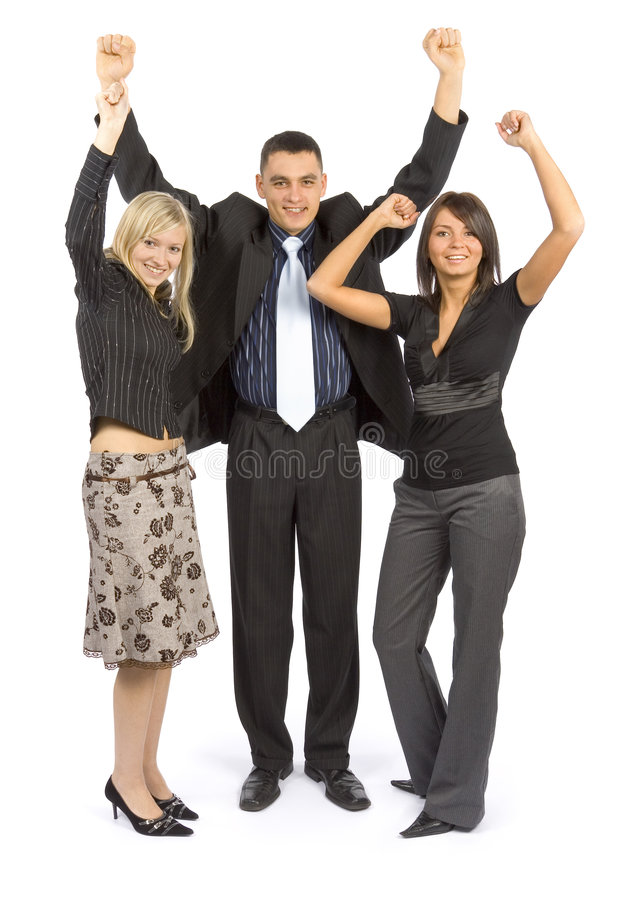Successful Businesspeople. Three businesspeople - one man and two women - smiling with arms raised in success. Isolated on white background stock photo