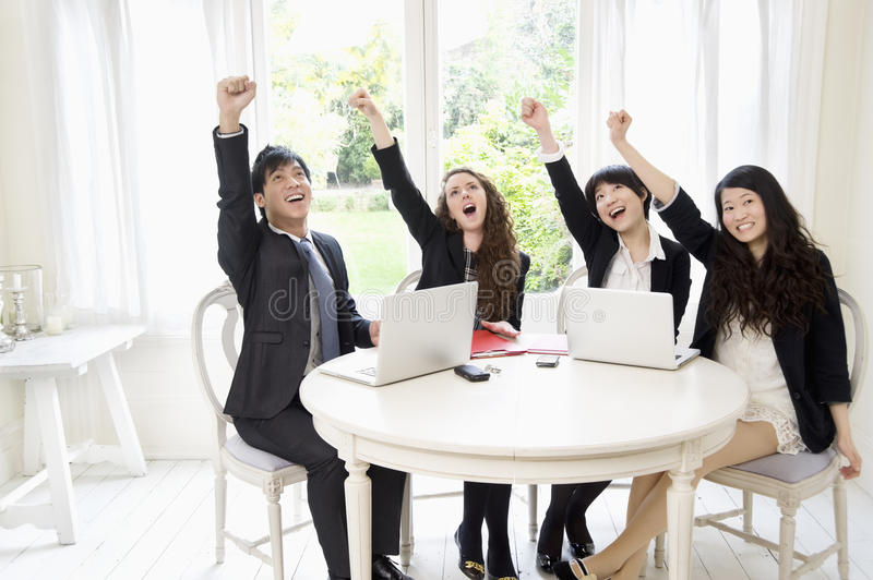 Successful Businesspeople With Hand Raised Royalty Free Stock Image