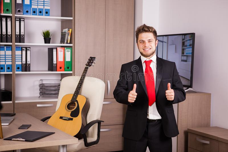 Successful businessperson showing thumbs up to the camera stock photos