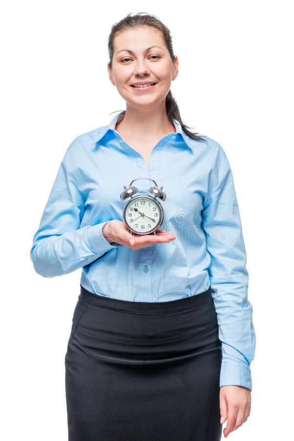 Successful businesswoman with an alarm clock in hands on a white stock photo
