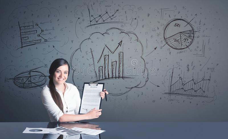 Businesswoman with business diagrams royalty free stock photo