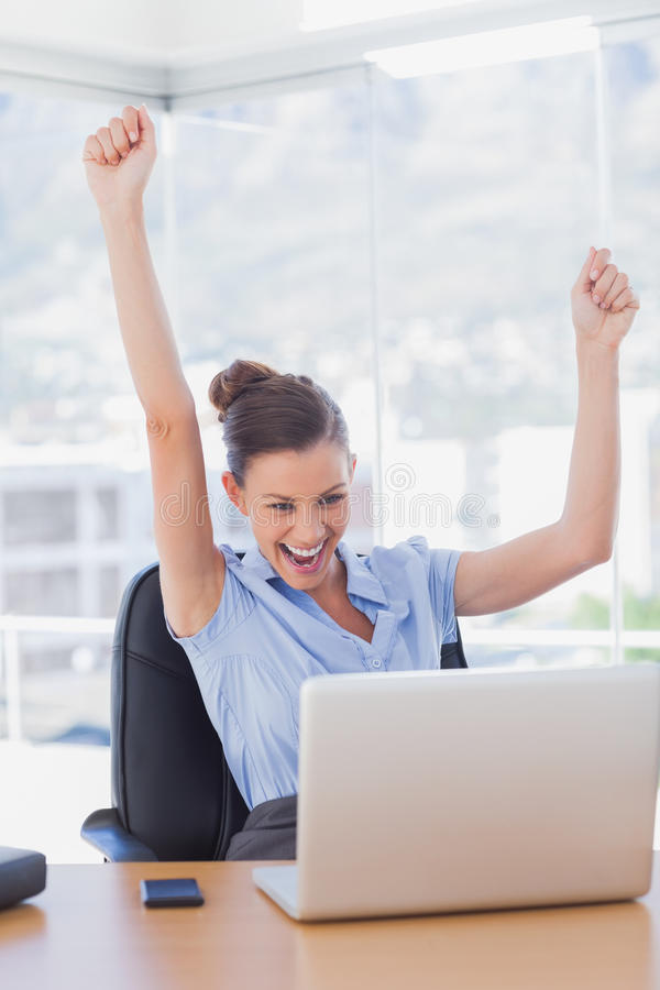 Successful businesswoman cheering royalty free stock photography