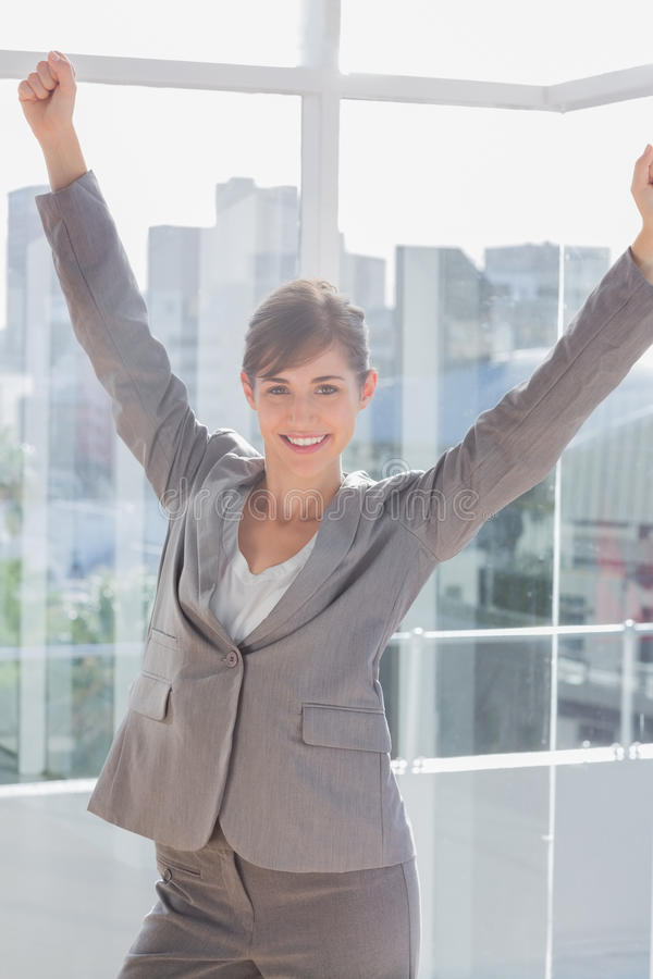Successful businesswoman cheering and smiling stock photography