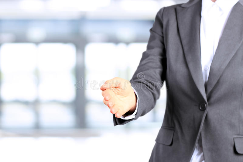 Successful businesswoman giving a hand.Ready to seal a deal stock images