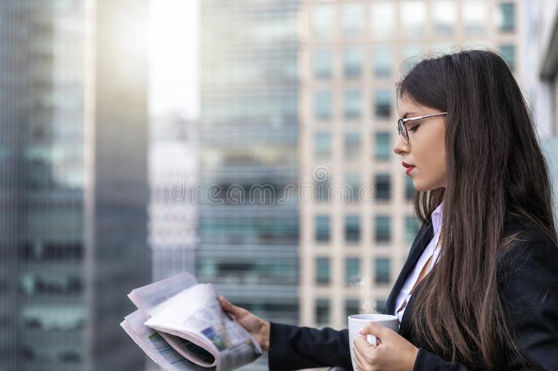 Successful businesswoman in front of modern office buildings in the city stock photo
