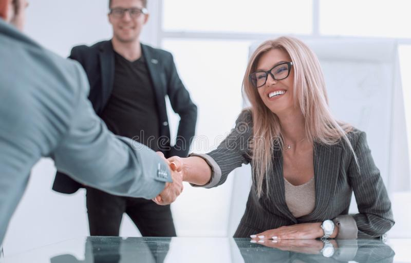 Successful businesswoman shaking hands with her business partner. Photo with copy space royalty free stock image
