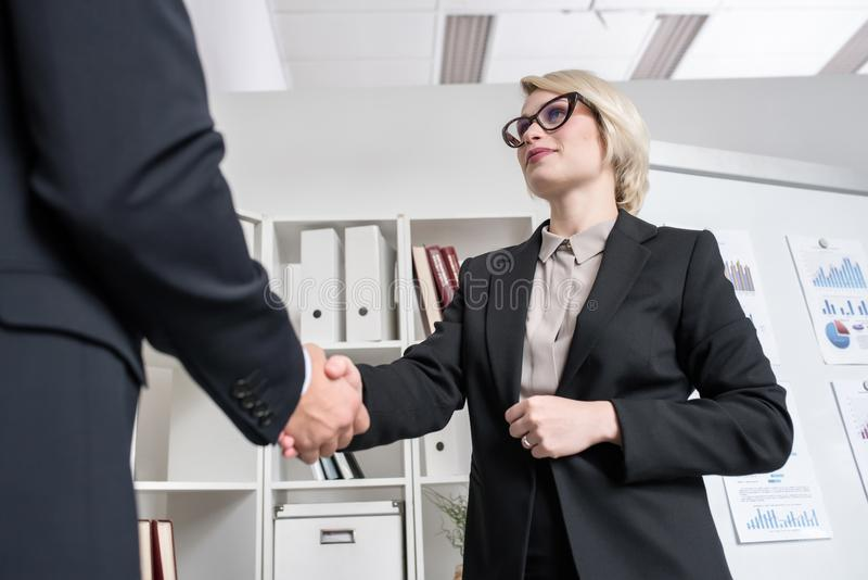Successful Businesswoman Shaking Hands with Partner stock images