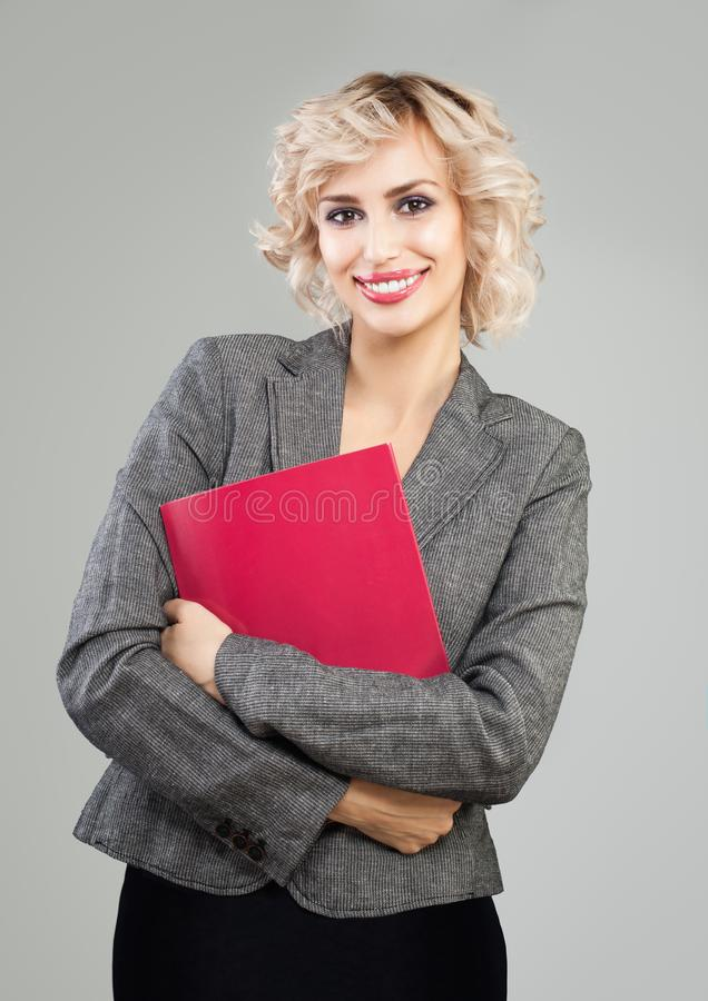 Successful businesswoman in suit holding red document case royalty free stock images