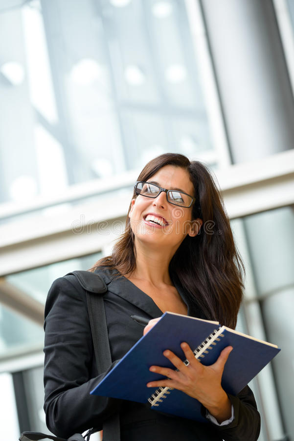Successful businesswoman taking notes stock image