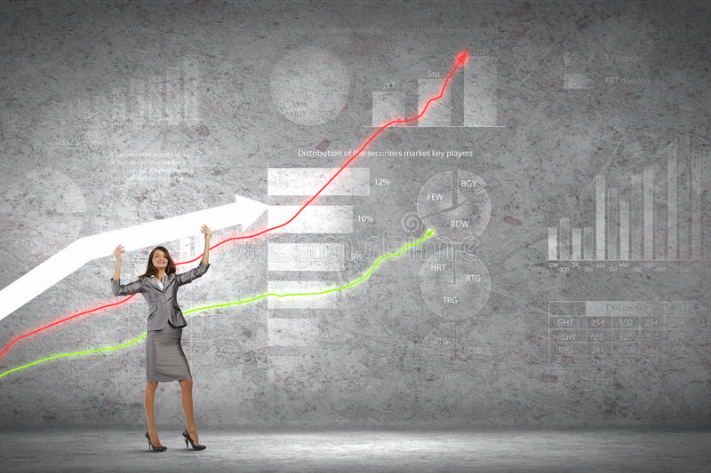 Successful businesswoman. Young businesswoman in suit with increasing arrow in hand stock image