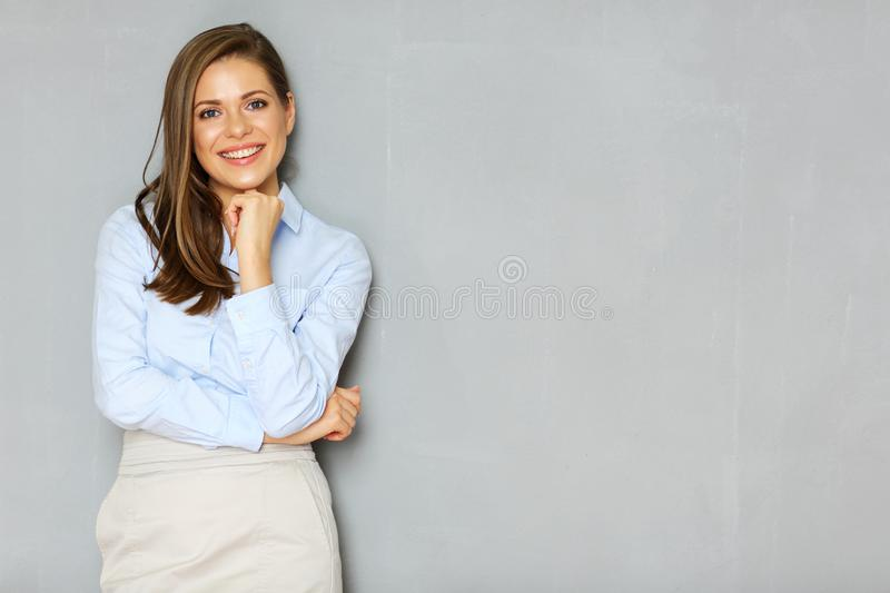 Successful busineswoman portrait on office wall background. Empty copy space stock photography
