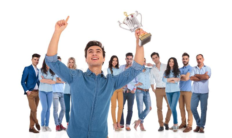 Successful casual team with young leader celebrating in front stock photos