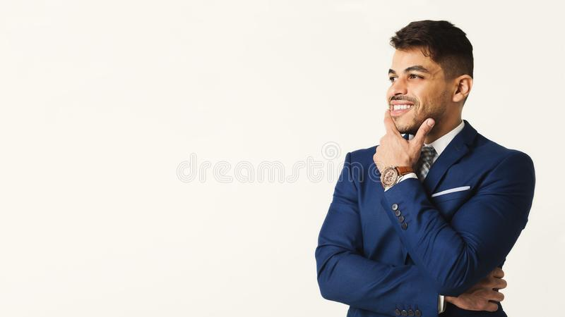 Successful arab businessman at white background, copy space royalty free stock photography