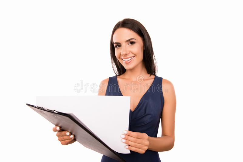 Successful cheerful businesswoman exploring documents stock photo