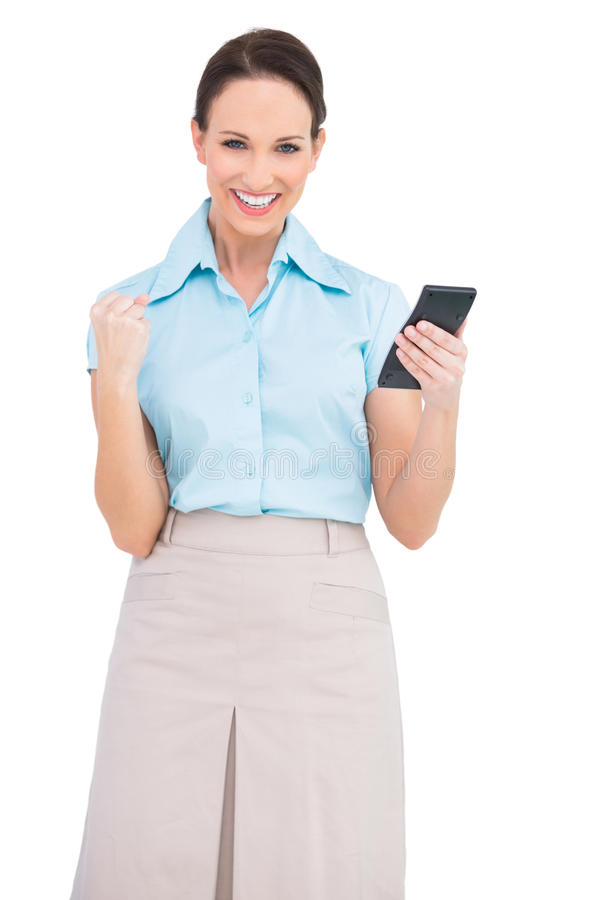 Successful classy businesswoman using calculator royalty free stock photo