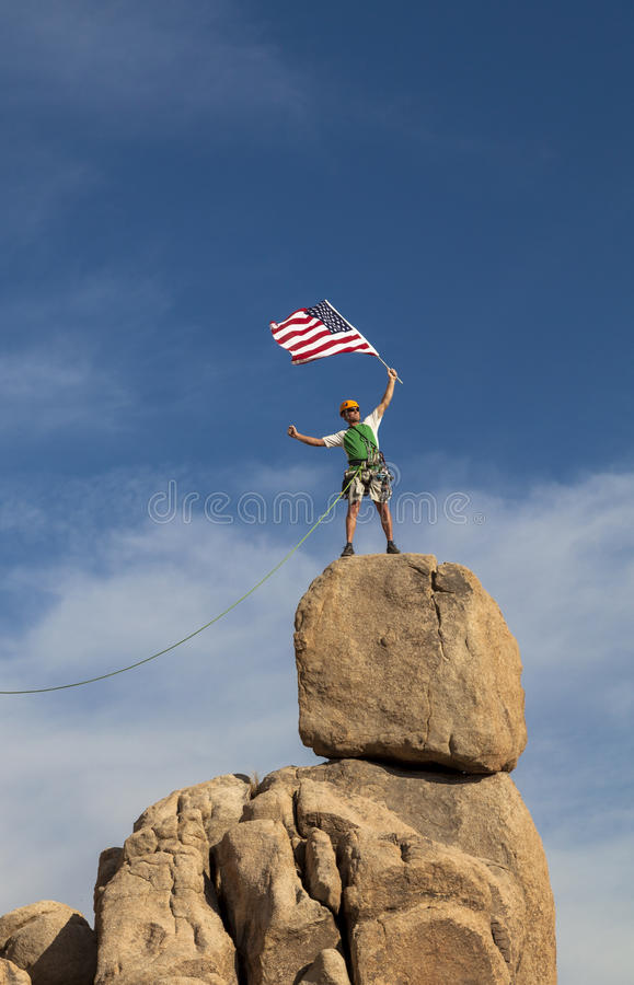 Successful climber at the top. stock image