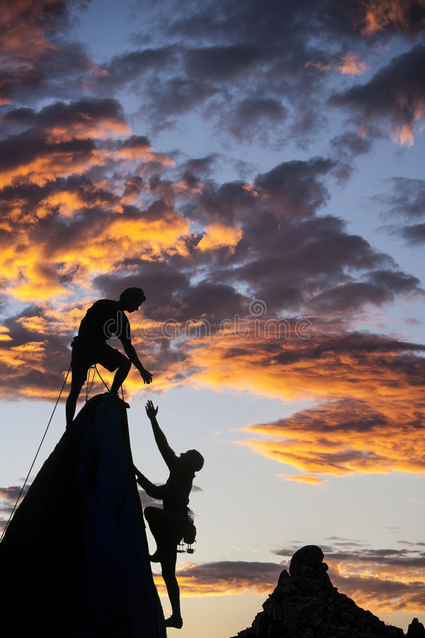 Successful climbing team. stock photography