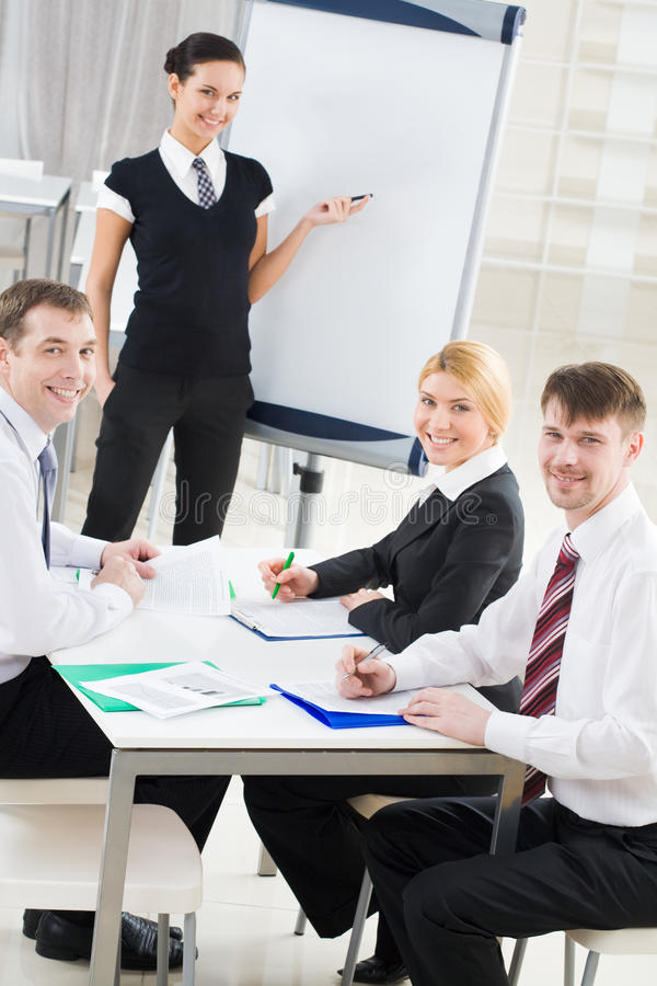 Successful co-workers stock images