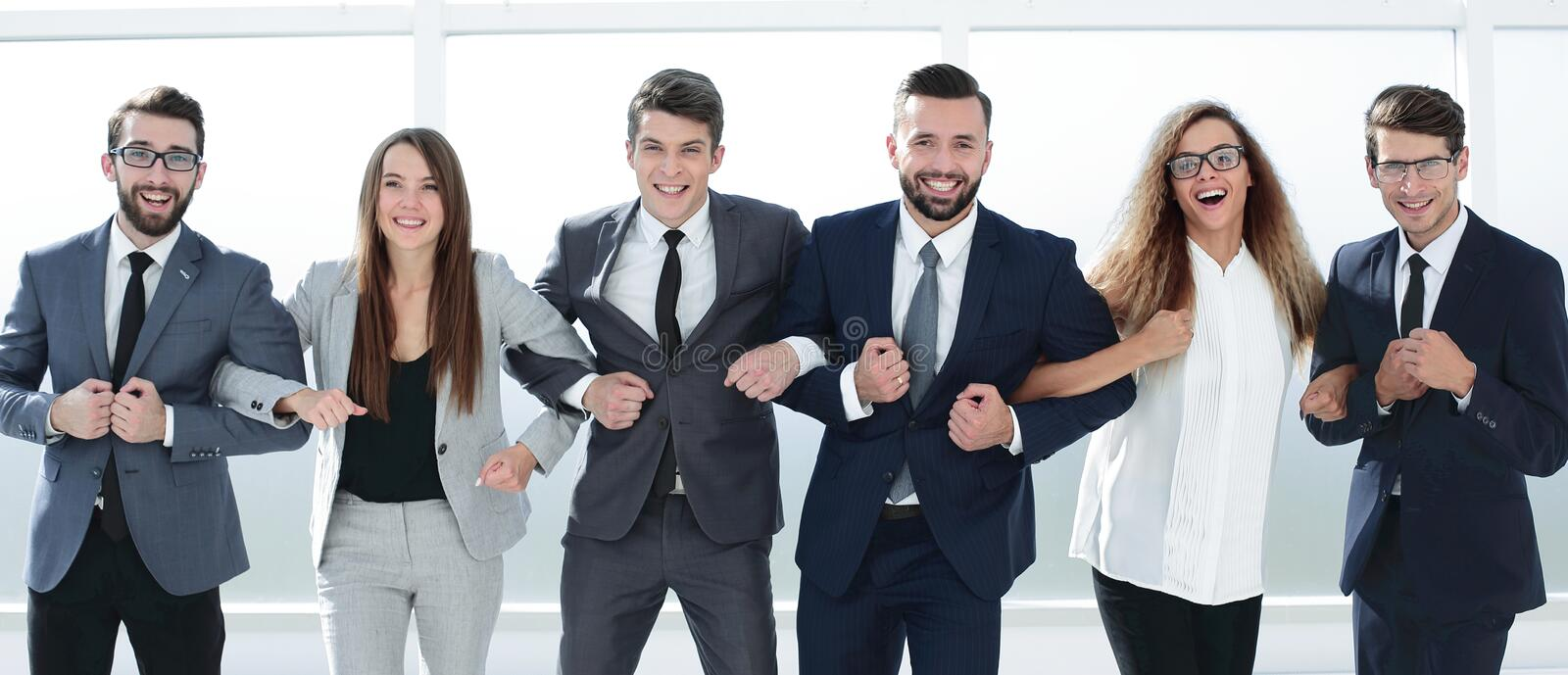 Successful cohesive business team standing together royalty free stock photography