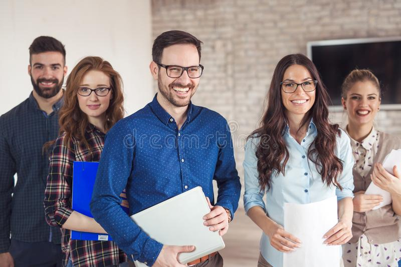 Successful company with happy workers stock image