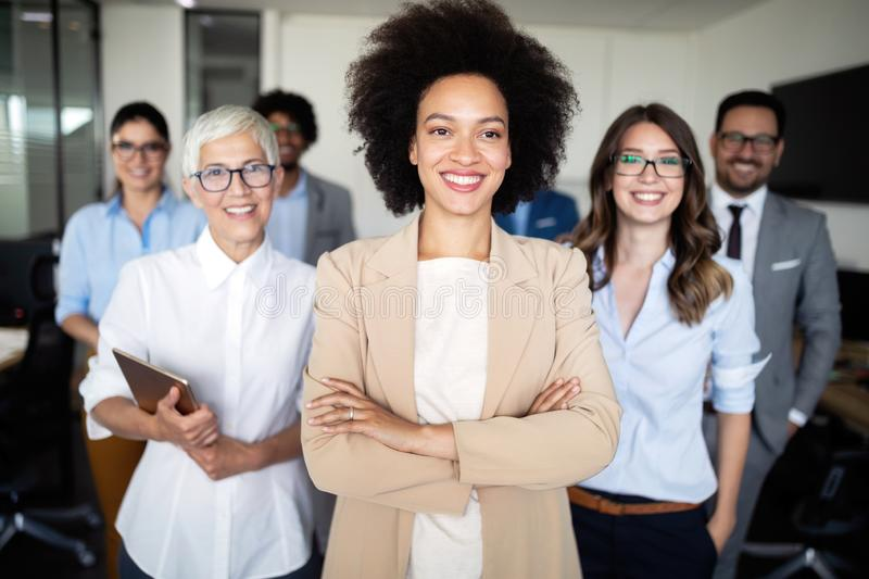 Successful company with happy workers in office royalty free stock photos