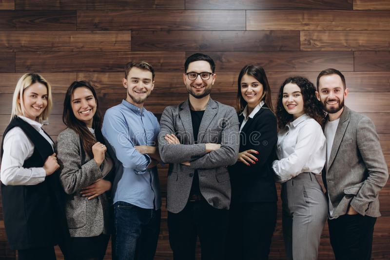Successful company with happy workers standing in row in modern office stock photo