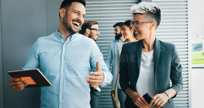 Successful company with happy workers stock images