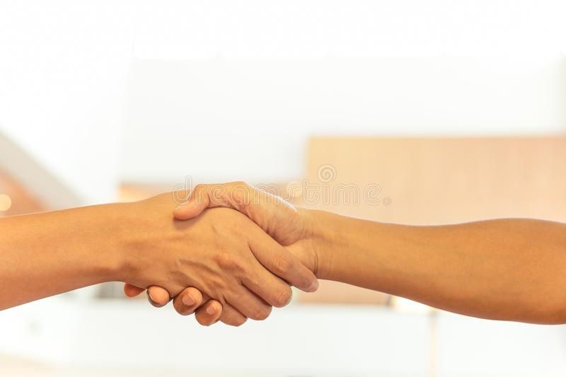 Successful conceptual people hand shaking hands royalty free stock photo