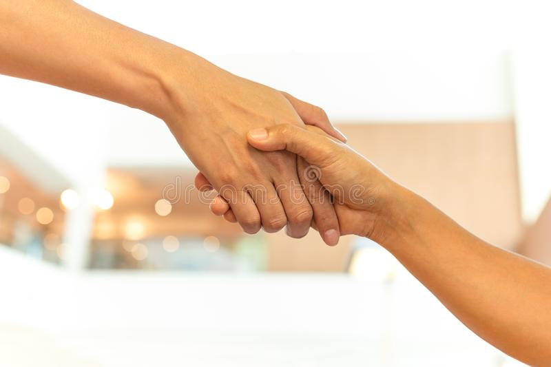 Successful conceptual people hand shaking hands royalty free stock photography