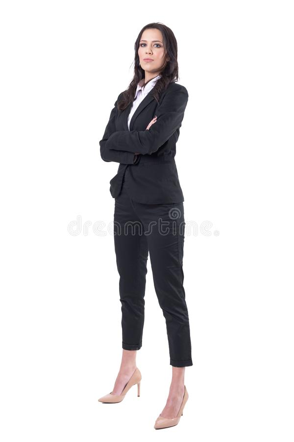 Successful confident elegant female business manager in black suit with crossed arms looking at camera royalty free stock images