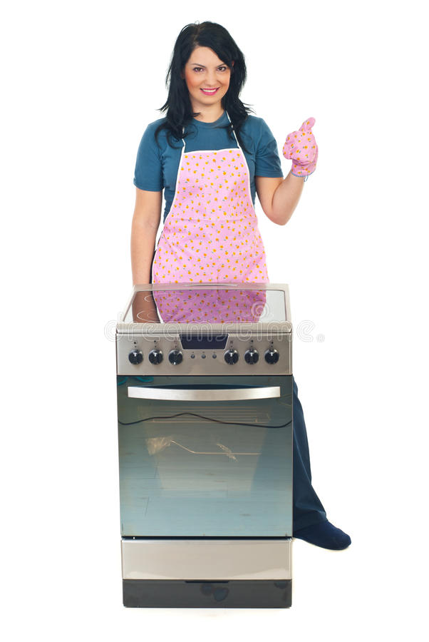 Successful cook woman give thumbs royalty free stock image