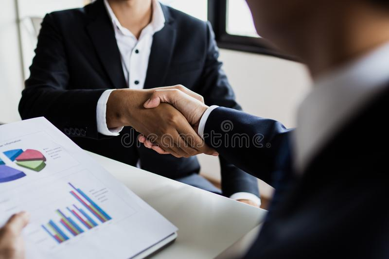 Successful cooperation and confident partner concept, people shake hands with customer after successful agreement business. Team, teamwork, connection royalty free stock photo