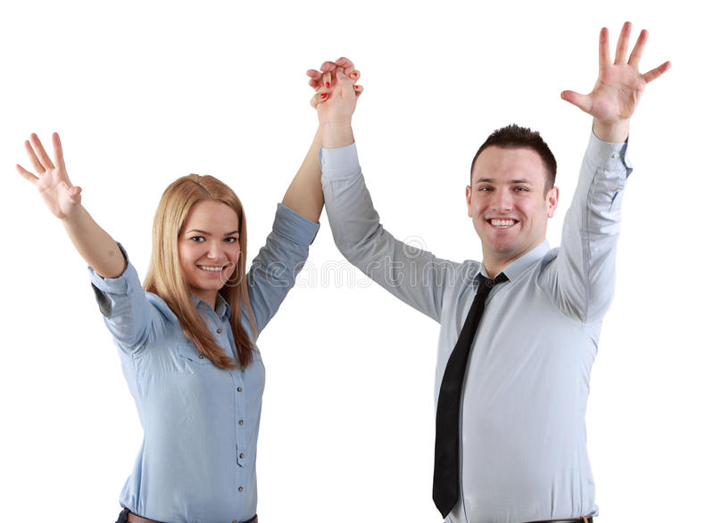 Successful couple. Young couple celebrating their success with hands raised isolated against a white background royalty free stock images