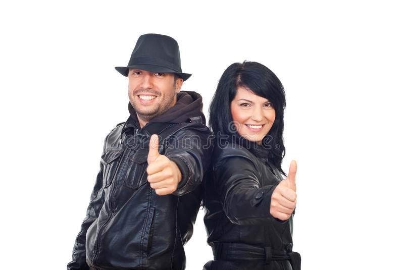 Successful couple giving thumbs stock images