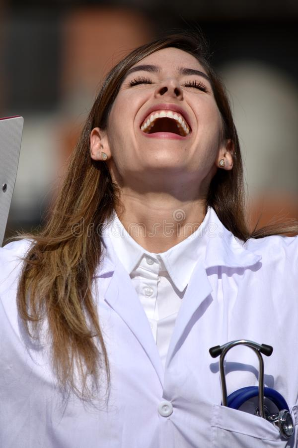Successful Cute Colombian Female Medic With Clipboard. A pretty young Colombian adult female stock photo