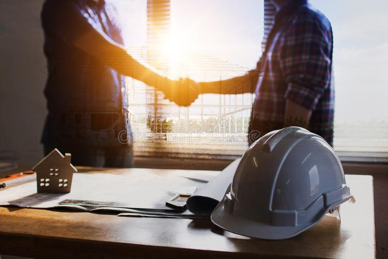 successful deal meeting and negotiate concept, architect or engineer shake hands with client in office stock photo