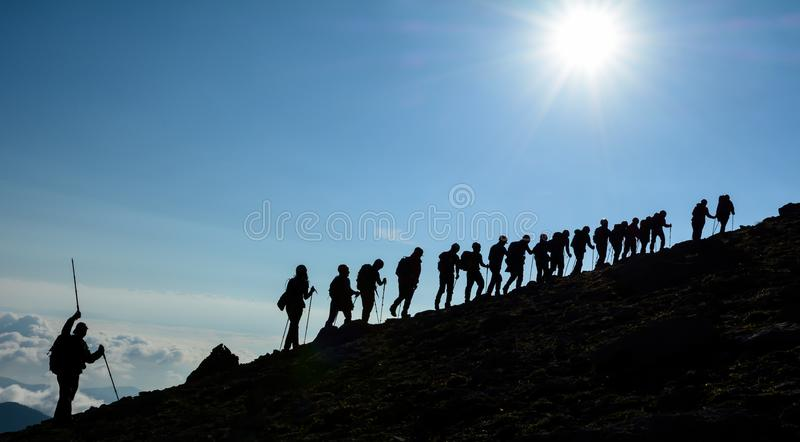 people walking in the legendary mountains royalty free stock photos