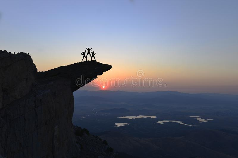 Successful discovery and happiness of mountaineers stock photo