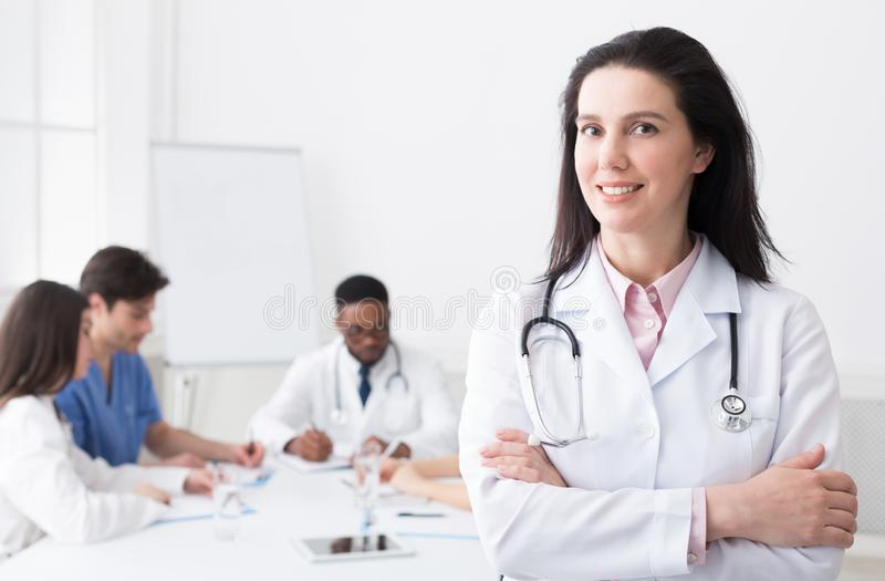 Successful Doctor Looking At Camera During Conference. In Meeting Room stock photography