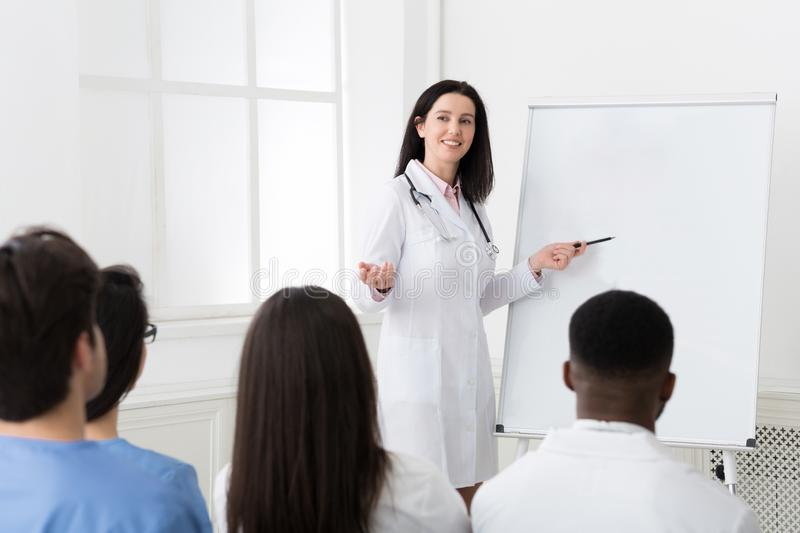Successful doctor sharing experience with colleagues in hospital royalty free stock photo