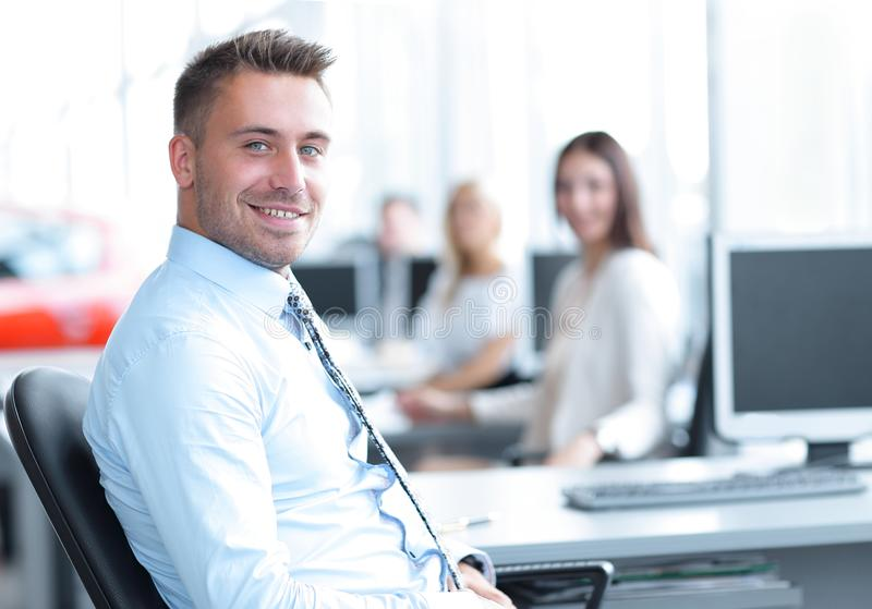 Successful employee sitting behind a Desk and looking at the camera. Employee sitting behind a Desk and looking at the camera. photo with copy space royalty free stock photos