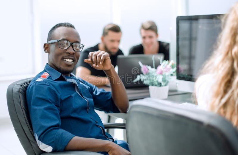 Successful employee sitting at the Desk. Business people royalty free stock images