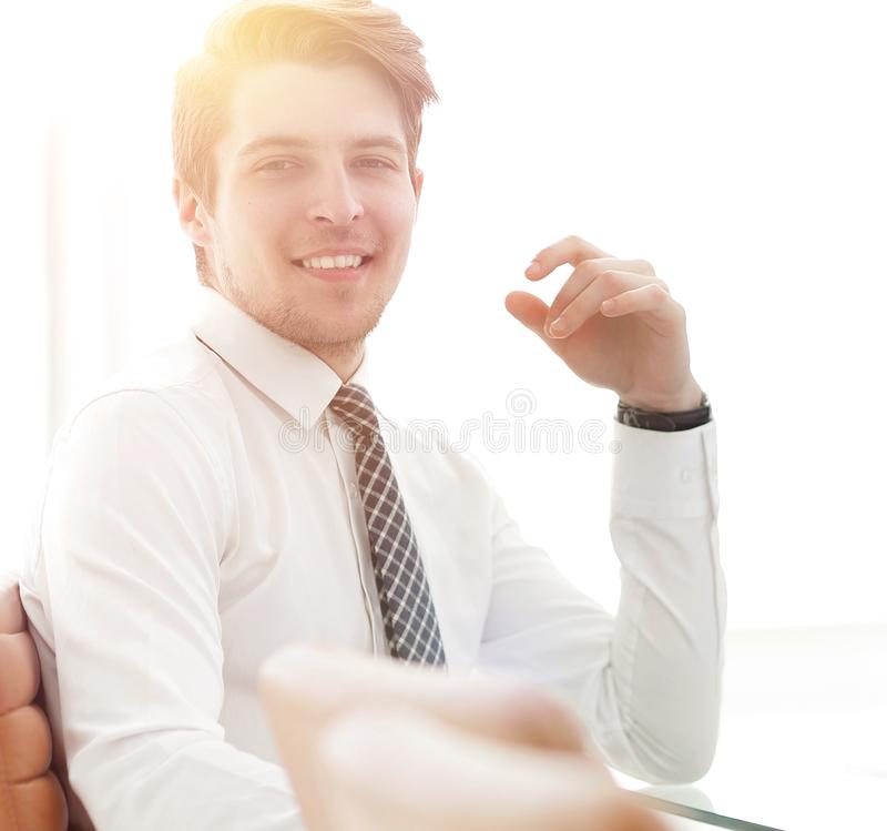 Employee sitting in front of a computer screen. Successful employee sitting in front of a computer screen.photo with copy space stock photos