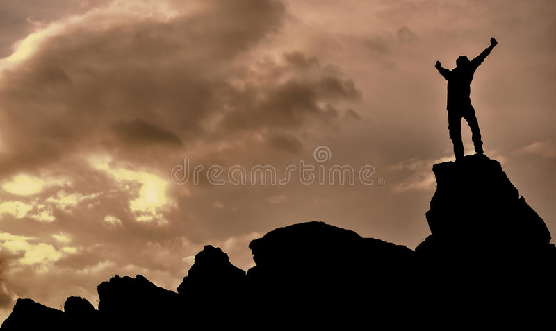 Successful & enthusiastic. Reaching the Summit, success and happiness in the rough stock photography