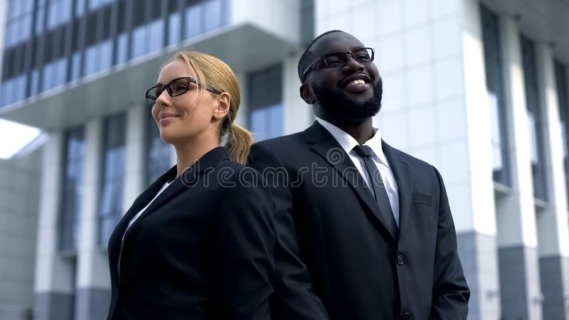 Successful entrepreneurs pose for camera, professionals in business development stock photos