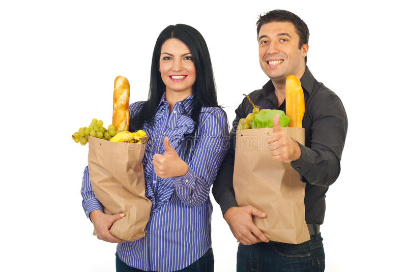 Successful family holding bags with food royalty free stock image
