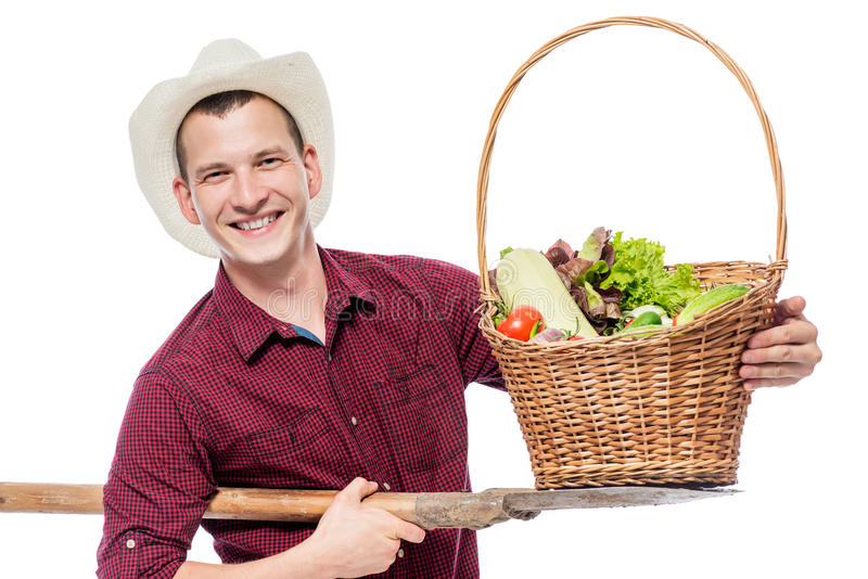 Successful farmer with a crop of vegetables in the studio. On a white background royalty free stock photos