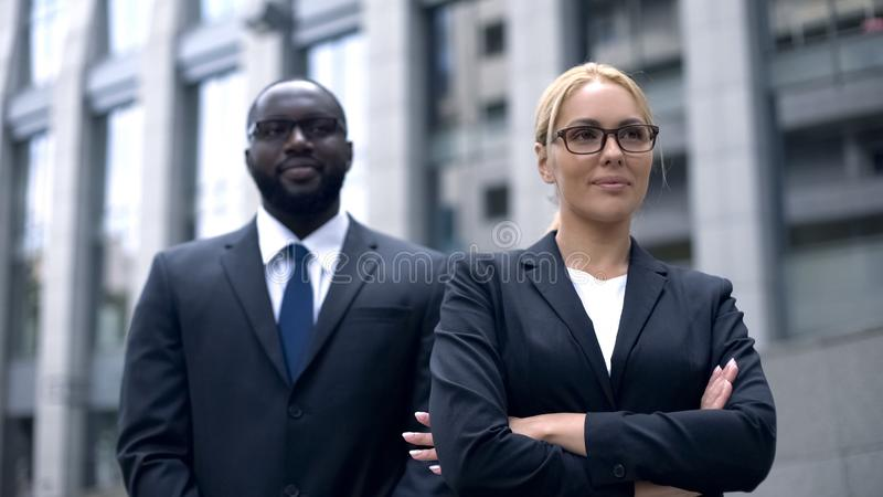 Successful female boss with bodyguard, feeling save and protected, security royalty free stock images